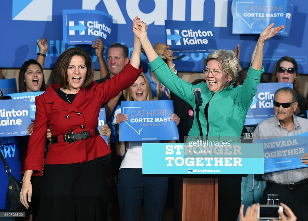 Former Nevada Attorney General and US Senate candidate Catherine Cortez Masto and US Sen Elizabeth Warren gesture to the crowd after speaking at The...