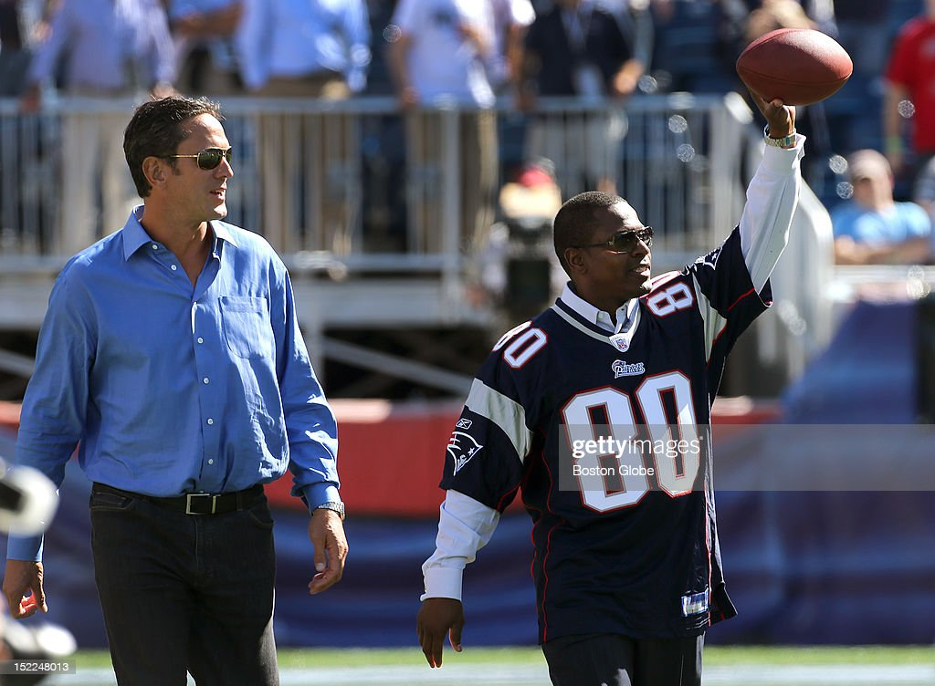 Former New England Patriots Hall of Fame quarterback Drew Bledsoe and Patriots Hall of Fame inductee Troy Brown hooked up on the field for one final pass completion during a half time ceremony honoring Brown as the New England Patriots play the Arizona Cardinals in the season home opener at Gillette Stadium in Foxborough.