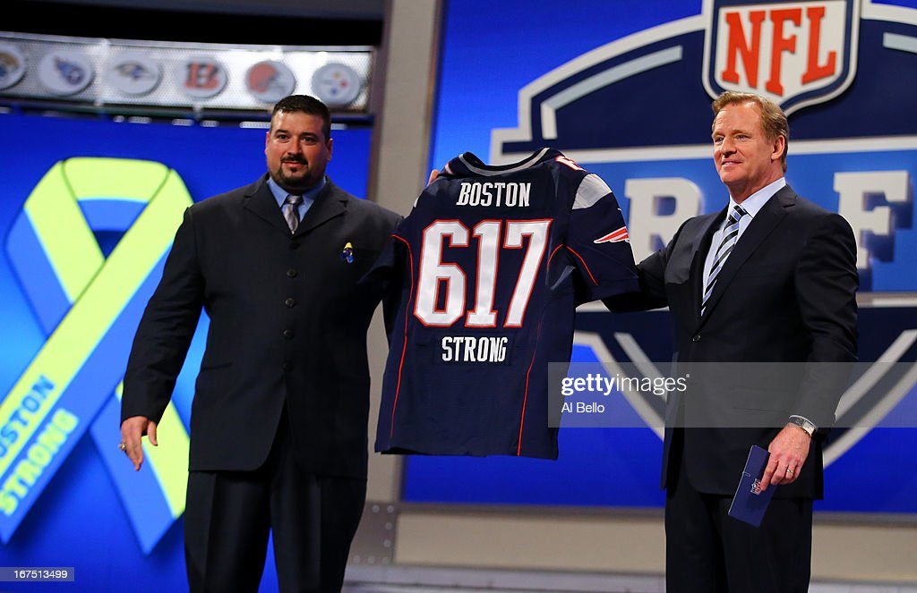Former New England Patriots player <a gi-track='captionPersonalityLinkClicked' href=/galleries/search?phrase=Joe+Andruzzi&family=editorial&specificpeople=749565 ng-click='$event.stopPropagation()'>Joe Andruzzi</a> (L) and NFL Commissioner <a gi-track='captionPersonalityLinkClicked' href=/galleries/search?phrase=Roger+Goodell&family=editorial&specificpeople=744758 ng-click='$event.stopPropagation()'>Roger Goodell</a> hold up a New England Patriot jersey with the # 617 on it in honor of the victims and those affected by this years bombing at the Boston Marathon in the first round of the 2013 NFL Draft at Radio City Music Hall on April 25, 2013 in New York City.