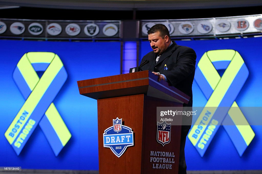 Former New England Patriots player <a gi-track='captionPersonalityLinkClicked' href=/galleries/search?phrase=Joe+Andruzzi&family=editorial&specificpeople=749565 ng-click='$event.stopPropagation()'>Joe Andruzzi</a> stands at the pdium as talks about the Bombing which occured during thir years Boston Marathon in the first round of the 2013 NFL Draft at Radio City Music Hall on April 25, 2013 in New York City.