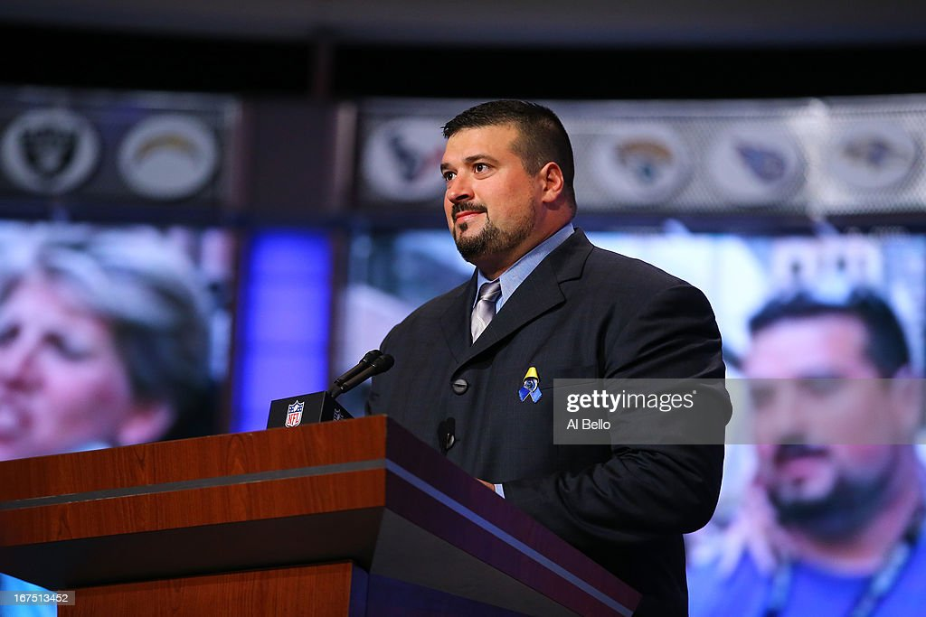 Former New England Patriots player Joe Andruzzi stands at the pdium as talks about the Bombing which occured during thir years Boston Marathon in the first round of the 2013 NFL Draft at Radio City Music Hall on April 25, 2013 in New York City.