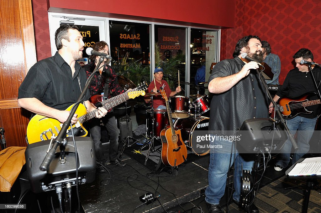 Former New England Patriots Quarterback Doug Flutie and the Flutie Brothers Band perform at the10th Annual Flutie Bowl to strike out autism at KINGS on January 28, 2013 in Boston, Massachusetts.