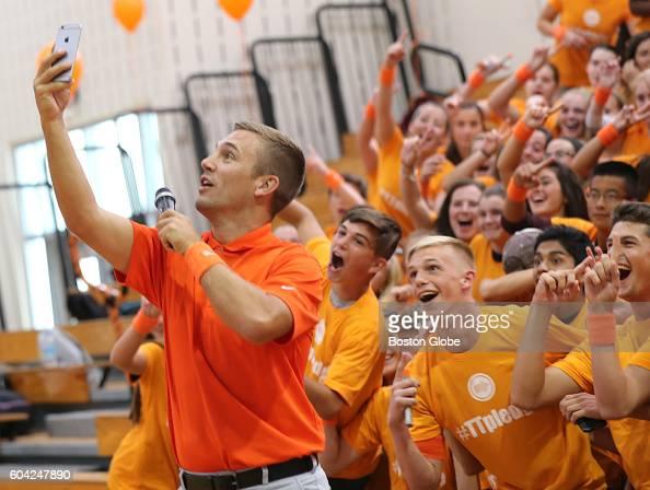 Former New England Revolution player Taylor Twellman takes a selfie with GrotonDunstable High School athletes as a kick off to the MIAA's Concussion...