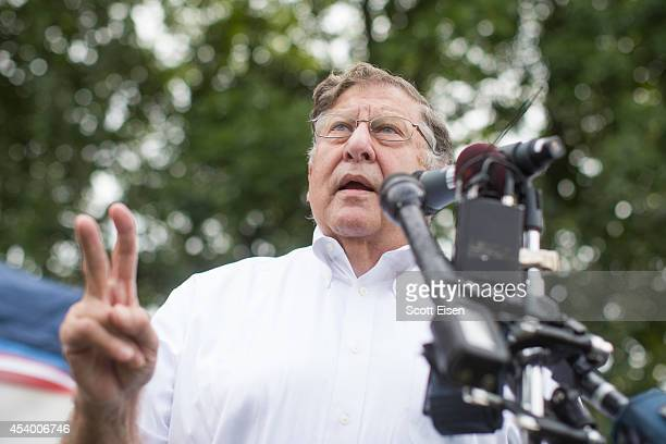 Former New Hampshire Governor John H Sununu introduces Texas Governor Rick Perry during a GOP event August 23 2014 in Stratham New Hampshire Perry...