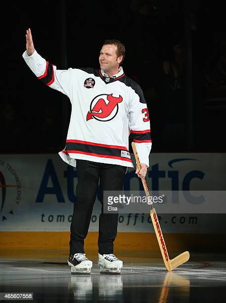 Former New Jersey Devils goaltender Martin Brodeur greets the fans during introductions of the 1995 Stanley Cup Champions team during a ceremony...
