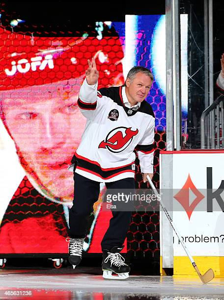 Former New Jersey Devils player Claude Lemieux is introduced during a ceremony honoring the 1995 Stanley Cup Championship team before the game...