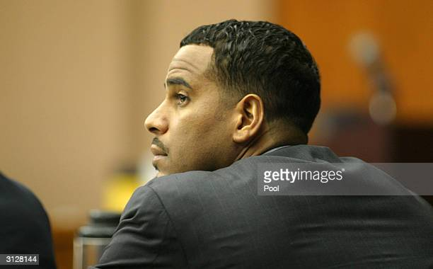 Former New Jersey Nets center Jayson Williams listens to testimony during his manslaughter trial March 24 2004 in Somerville New Jersey Williams is...