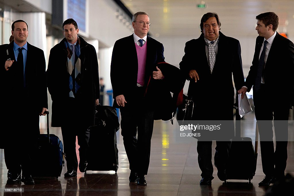 Former New Mexico governor Bill Richardson (2nd R) and Google chairman Eric Schmidt (C) arrive at Beijing airport from North Korea on January 10, 2013. Richardson and Schmidt met with reporters following their visit to secretive North Korea calling for greater Internet freedom for the welfare of its people. AFP PHOTO / Ed Jones