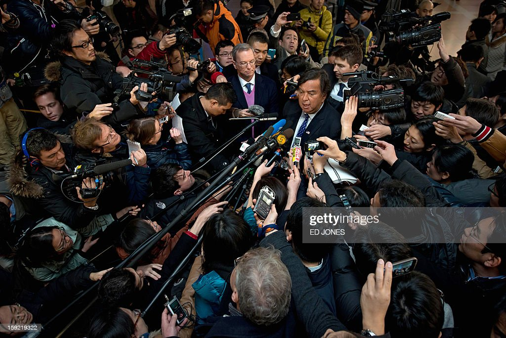 Former New Mexico governor Bill Richardson (C) and Google chairman Eric Schmidt (centre L) speak to a pack of media upon their arrival at Beijing airport from North Korea on January 10, 2013. Richardson and Schmidt met with reporters following their visit to secretive North Korea calling for greater Internet freedom for the welfare of its people. AFP PHOTO / Ed Jones