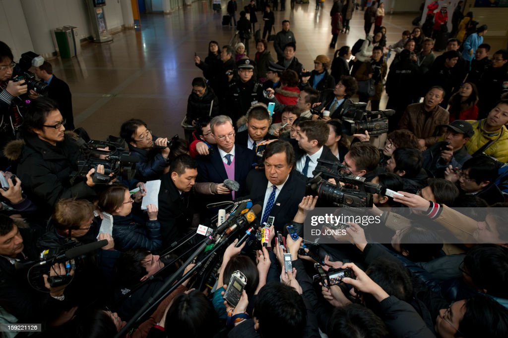 Former New Mexico governor Bill Richardson (C) and Google chairman Eric Schmidt (centre L) talk to the media after arriving at Beijing airport from North Korea on January 10, 2013. Richardson and Schmidt met with reporters following their visit to secretive North Korea calling for greater internet freedom for the welfare of its people. AFP PHOTO / Ed Jones