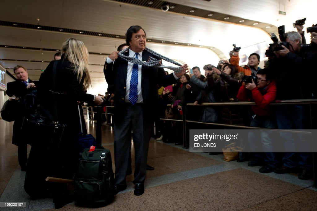Former New Mexico governor Bill Richardson (C) prepares to talk to the media after arriving at Beijing airport from North Korea on January 10, 2013. Richardson and Google chairman Eric Schmidt met with reporters following their visit to secretive North Korea calling for greater Internet freedom for the welfare of its people. AFP PHOTO / Ed Jones