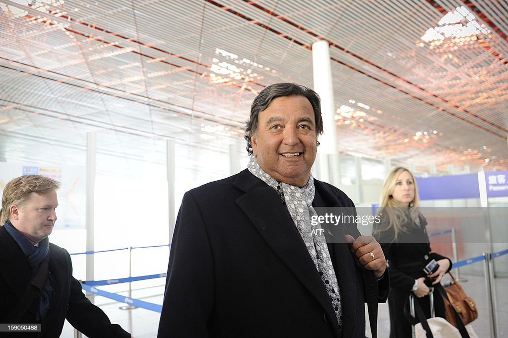 Former New Mexico Governor Bill Richardson (C) smiles as he responds to the media at Beijing International airport in Beijing on January 7, 2013, before his trip to North Korea. Former New Mexico governor Bill Richardson and Google chairman Eric Schmidt will head to North Korea on a 'private humanitarian mission,' Richardson's office said on January 5, 2012.
