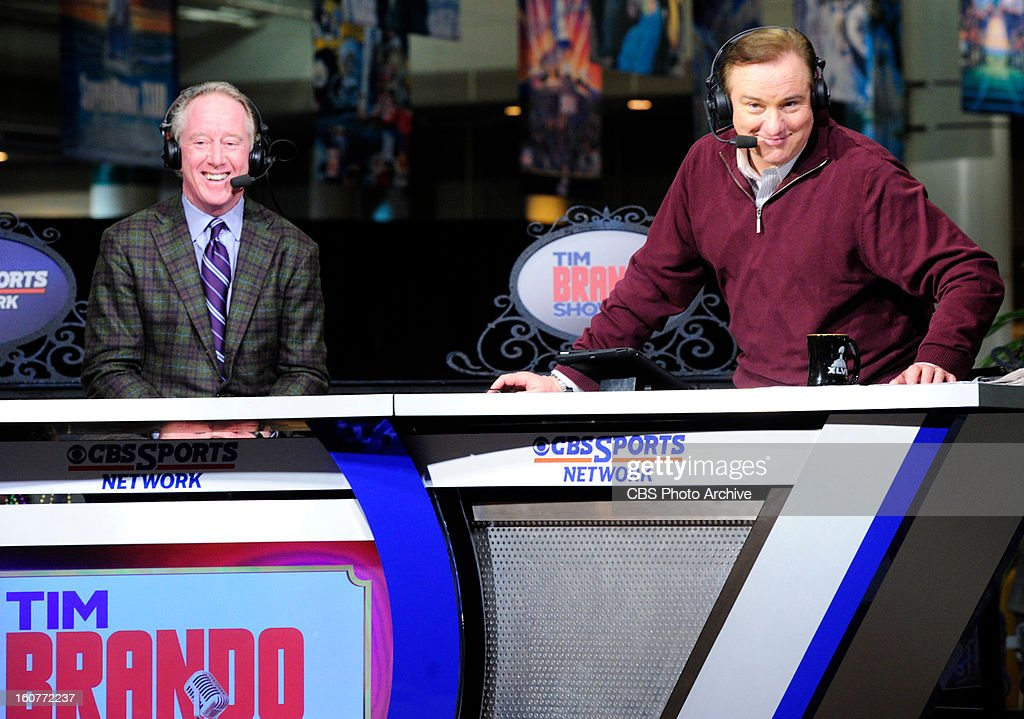 Former New Orleans Saints QB Archie Manning laughs as Tim Brando does a photo pose during his broadcast from Radio Row in New Orleans the site of SBXLVII on Thursday.