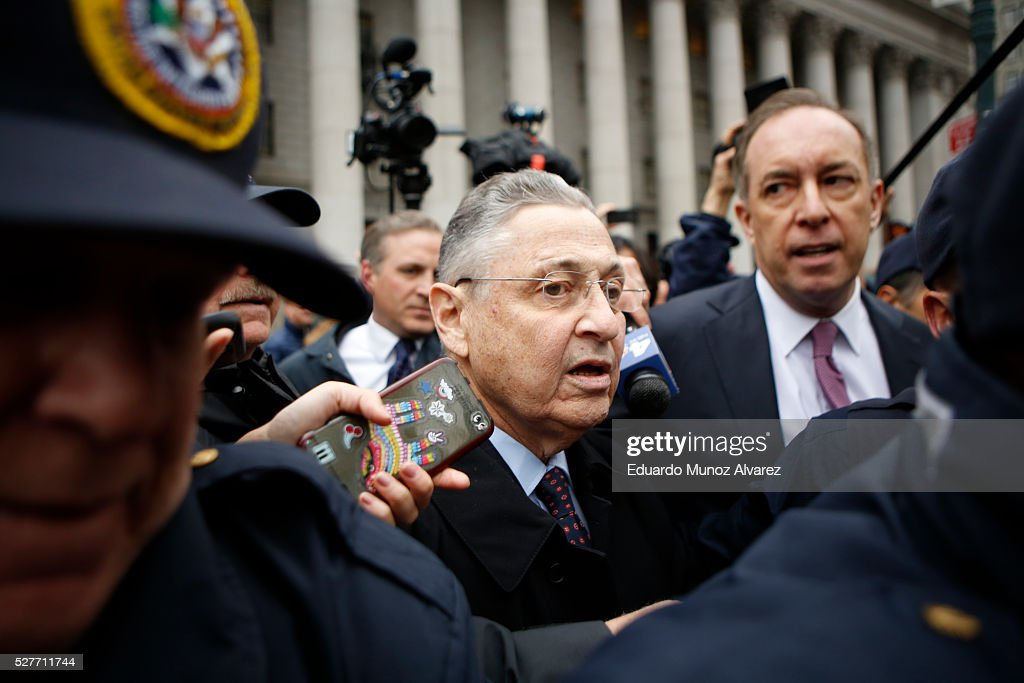 Former New York Assembly Speaker Sheldon Silver (C) exits federal court in Lower Manhattan on May 3, 2016 in New York City. Former New York state assembly speaker Silver was sentenced to 12 years in prison for corruption schemes that federal officials said captured $5 million over a span of two decades