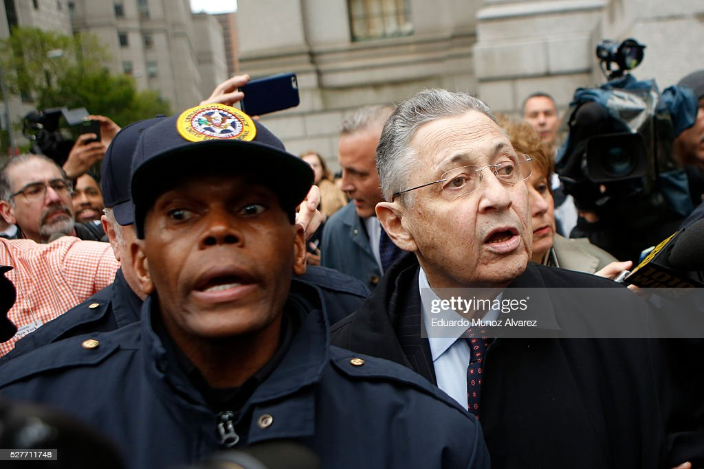 Former New York Assembly Speaker Sheldon Silver (R) is surrounded by media and USMS police court while he exits federal court in Lower Manhattan on May 3, 2016 in New York City. Former New York state assembly speaker Silver was sentenced to 12 years in prison for corruption schemes that federal officials said captured $5 million over a span of two decades
