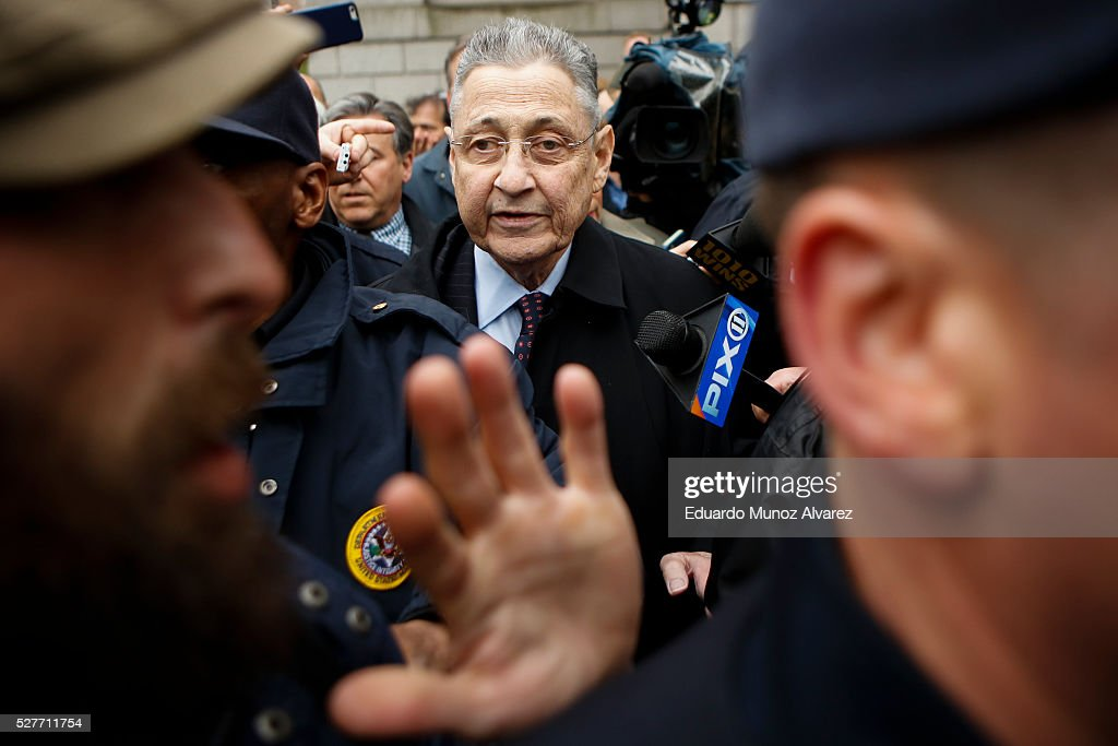 Former New York Assembly Speaker Sheldon Silver (C) is surrounded by media and USMS police court while he exits federal court in Lower Manhattan on May 3, 2016 in New York City. Former New York state assembly speaker Silver was sentenced to 12 years in prison for corruption schemes that federal officials said captured $5 million over a span of two decades