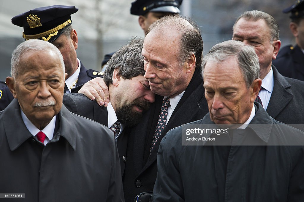 Former New York City Mayor <a gi-track='captionPersonalityLinkClicked' href=/galleries/search?phrase=David+Dinkins&family=editorial&specificpeople=171317 ng-click='$event.stopPropagation()'>David Dinkins</a>, left, and current New York City Mayor <a gi-track='captionPersonalityLinkClicked' href=/galleries/search?phrase=Michael+Bloomberg&family=editorial&specificpeople=171685 ng-click='$event.stopPropagation()'>Michael Bloomberg</a>, right, attend the 20th Anniversary Ceremony for the 1993 World Trade Center bombing at Ground Zero while Stephen Knapp, son of a victim of the attack, cries on the shoulder of Charles Maikish, former director of the World Trade Department, on February 26, 2013 in New York City. The attack, which utilized a car bomb and hit the north tower, killed six people.