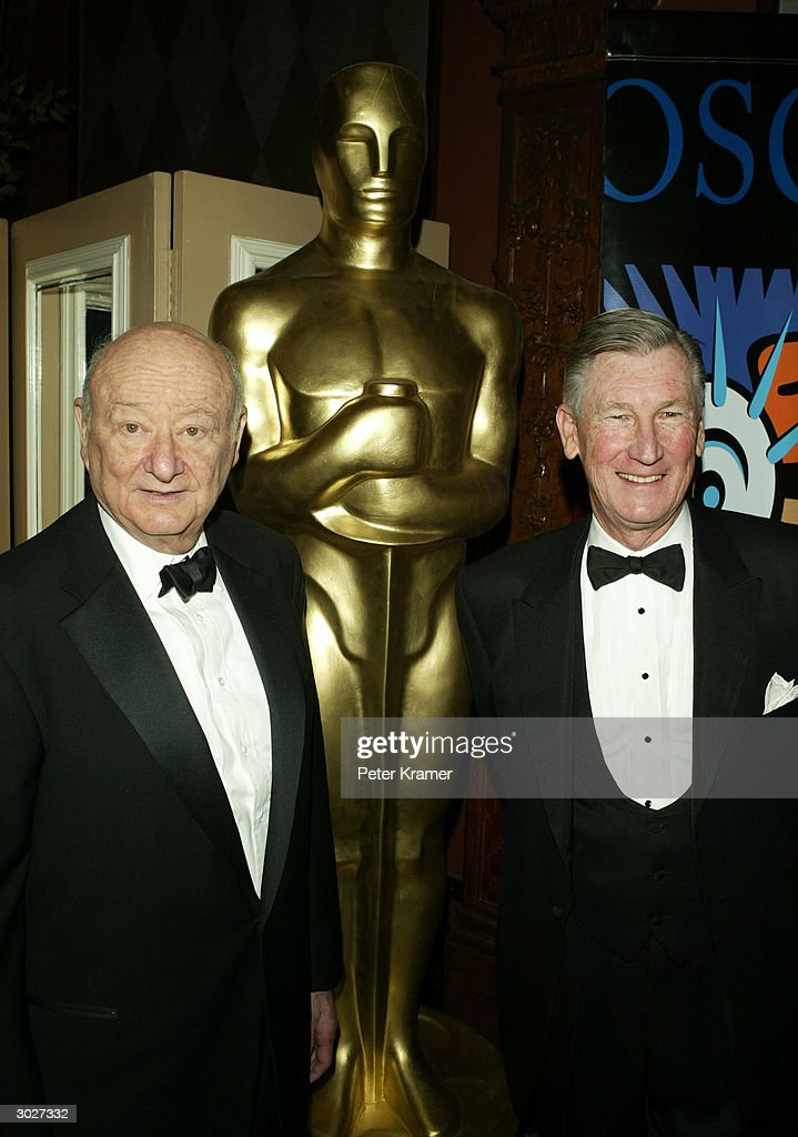 Former New York City Mayor Ed Koch and producer Robert Rehme attend the AMPAS Official Oscar Night Celebration at Le Cirque February 29, 2004 in New York City.