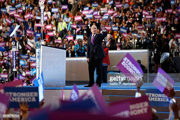 Former New York City Mayor Michael Bloomberg gestures to attendees after delivering remarks on the third day of the Democratic National Convention at...