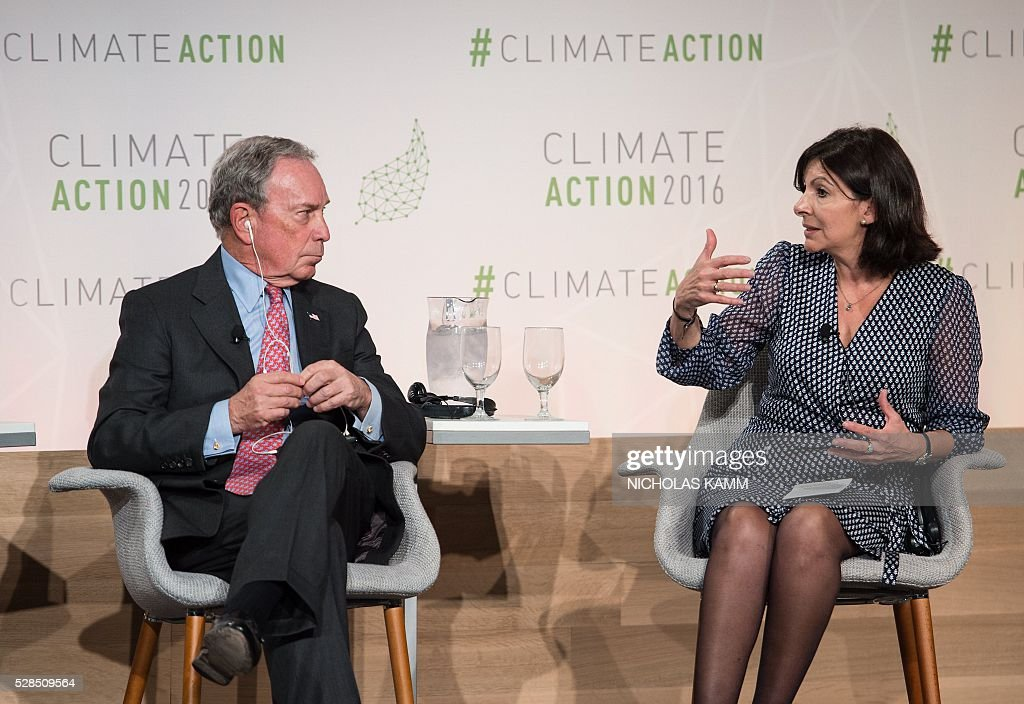 Former New York City mayor Michael Bloomberg (L), UN secretary-general's special envoy for cities and climate change and founding partner of the Compact of Mayors, and Paris mayor Anne Hidalgo participate in a discussio on 'Progress and Potential in the Months Since the Climate Summit for Local Leaders' at the Climate Action 2016 conference in Washington, DC, on May 5, 2016. / AFP / NICHOLAS