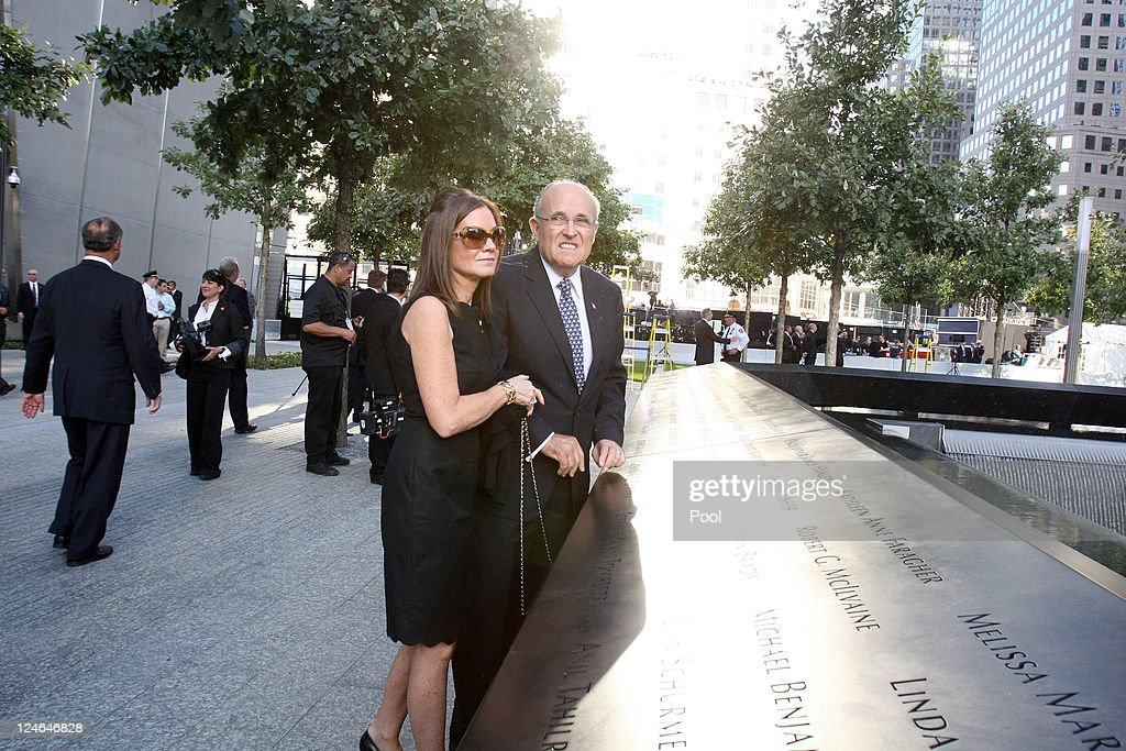 Former New York City mayor Rudy Giuliani and his wife Judith look out at the North Pool of the 9/11 Memorial during the tenth anniversary ceremonies...
