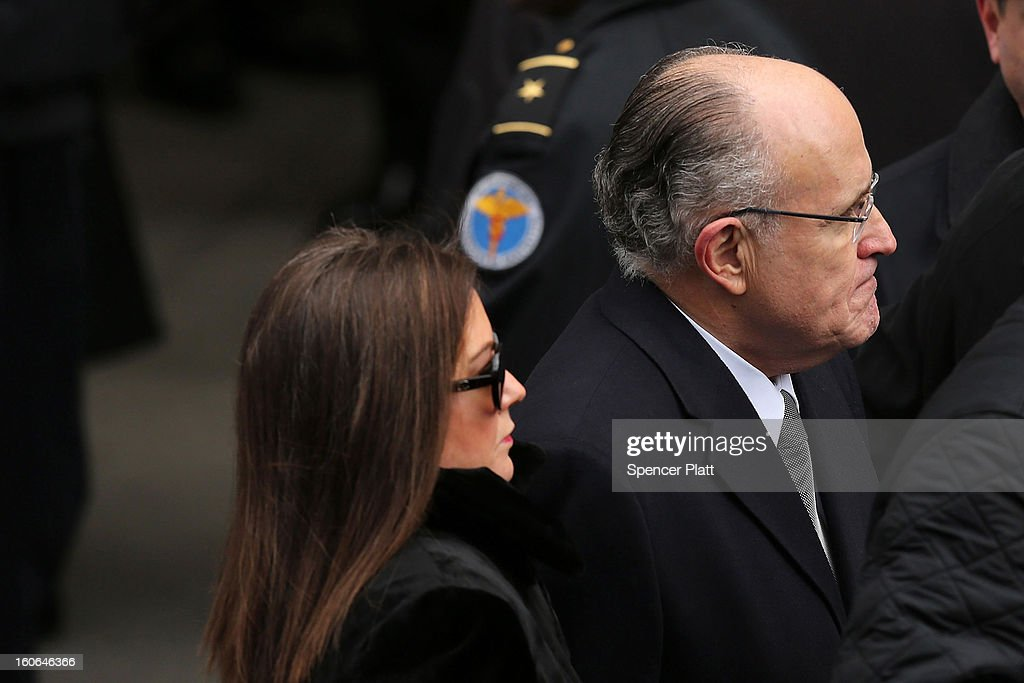 Former New York City Mayor Rudy Giuliani and his wife <a gi-track='captionPersonalityLinkClicked' href=/galleries/search?phrase=Judith+Nathan&family=editorial&specificpeople=215072 ng-click='$event.stopPropagation()'>Judith Nathan</a> attend funeral services for former New York City Mayor Ed Koch at Manhattan's Temple Emanu-El on February 4, 2013 in New York City.The iconic former New York mayor passed away on February 1, 2013 in New York City at age 88. Ed Koch was New York's 105th mayor and ran the city from 1978-89. He was often outspoken and combative and has been credited with rescuing the city from near-financial ruin during a three-term City Hall run. Former Governor Mario Cuomo is at left.