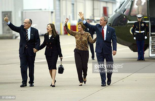Former New York City Mayor Rudy Giuliani and his wife Judith Nathan walk from Marine One with US President George W Bush and First Lady Laura Bush at...