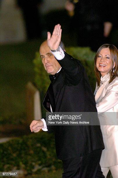 Former New York City Mayor Rudy Giuliani waves as he and wife Judith arrive at the Episcopal Church of BethesdabytheSea in Palm Beach Fla for the...