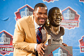 Former New York Giants defensive end Michael Strahan with his bust during the NFL Class of 2014 Pro Football Hall of Fame Enshrinement Ceremony at...