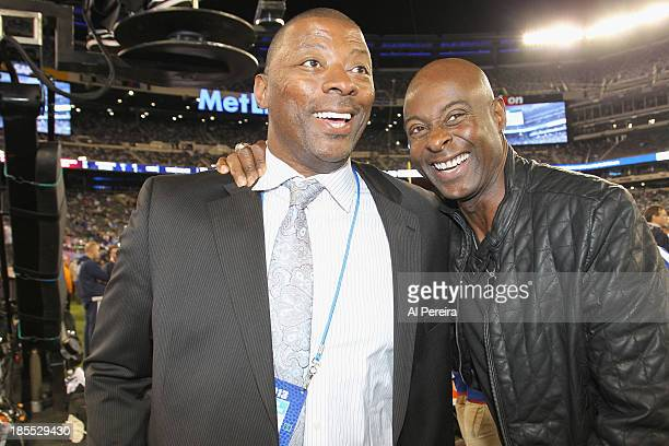 Former New York Giants star Carl Banks meets with former San Francisco 49ers great Jerry Rice before the New York Giants vs The Minnesota Vikings...