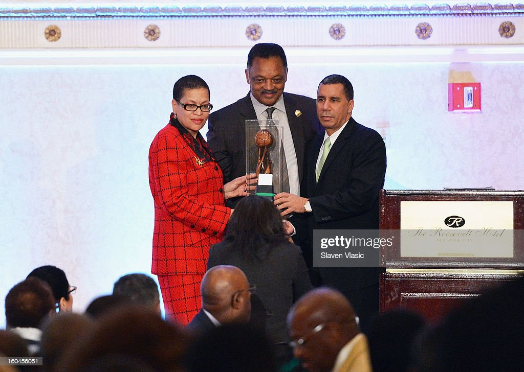 Former New York Governor <a gi-track='captionPersonalityLinkClicked' href=/galleries/search?phrase=David+Paterson+-+American+Politician&family=editorial&specificpeople=3006680 ng-click='$event.stopPropagation()'>David Paterson</a> (R) being honored by Rev. Jesse Jackson (C), founder and president of the Rainbow PUSH Coalition and organizer of the WSP at the 16th Annual Wall Street Project 'Access To Captial' luncheon at The Roosevelt Hotel on January 31, 2013 in New York City.