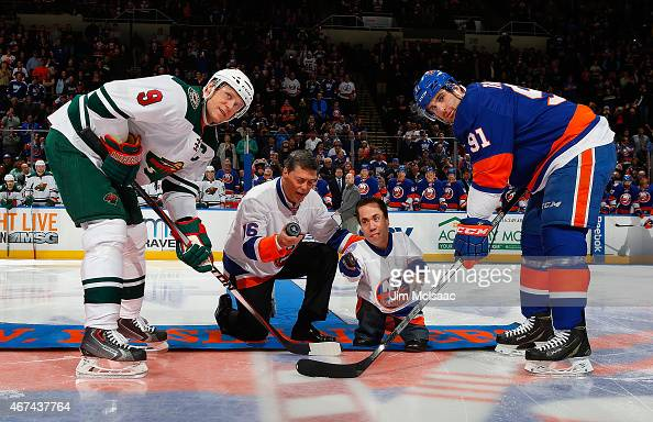 Former New York Islander and a member of the NHL Hall of Fame Pat LaFontaine and Pat's long time friend Clinton Brown drop the ceremonial puck to...