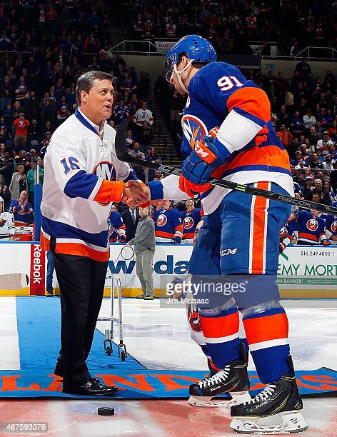 Former New York Islander and a member of the NHL Hall of Fame Pat LaFontaine shakes hands with John Tavares after being honored prior to the start of...