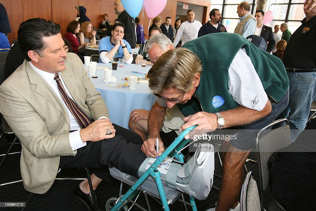 Former New York Jets Linebacker and current SNY personality Greg Buttle share a laugh with Spokesman <a gi-track='captionPersonalityLinkClicked' href=/galleries/search?phrase=Joe+Namath&family=editorial&specificpeople=91230 ng-click='$event.stopPropagation()'>Joe Namath</a> while he signs his cast at the 2007 March of Dimes Walk America in New York City, April 29, 2007.