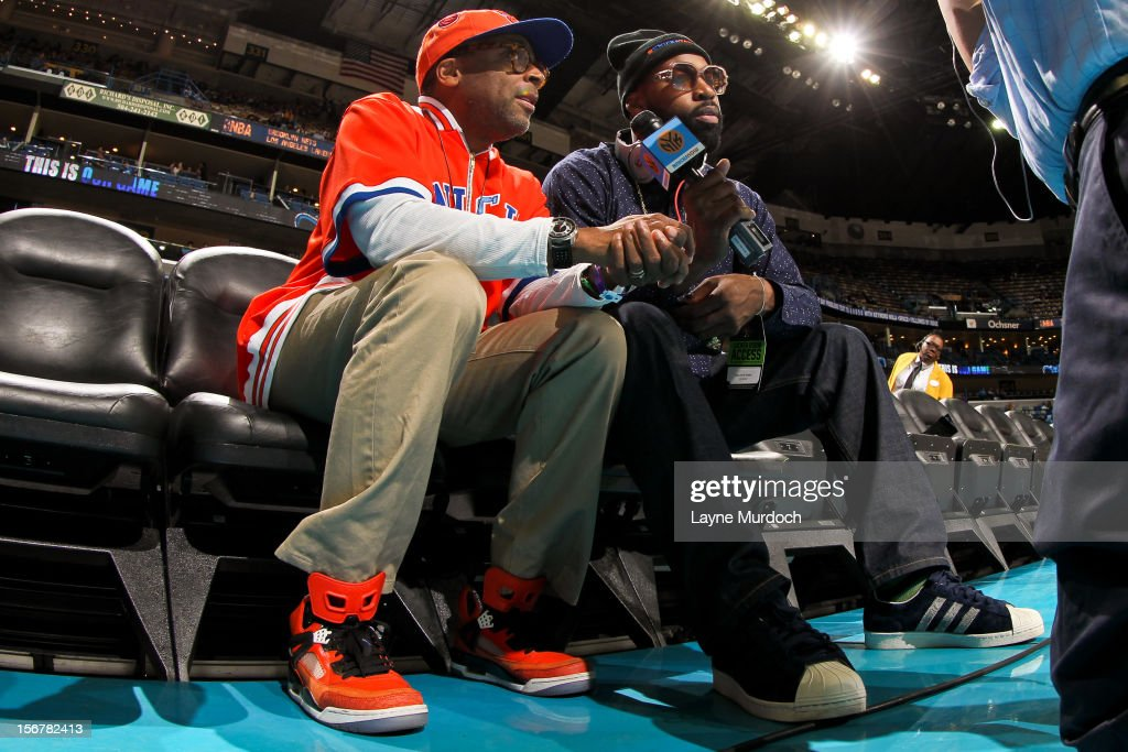 Former New York Knicks player Baron Davis, right, interviews film director Spike Lee before a game between the Knicks and New Orleans Hornets on November 20, 2012 at the New Orleans Arena in New Orleans, Louisiana.