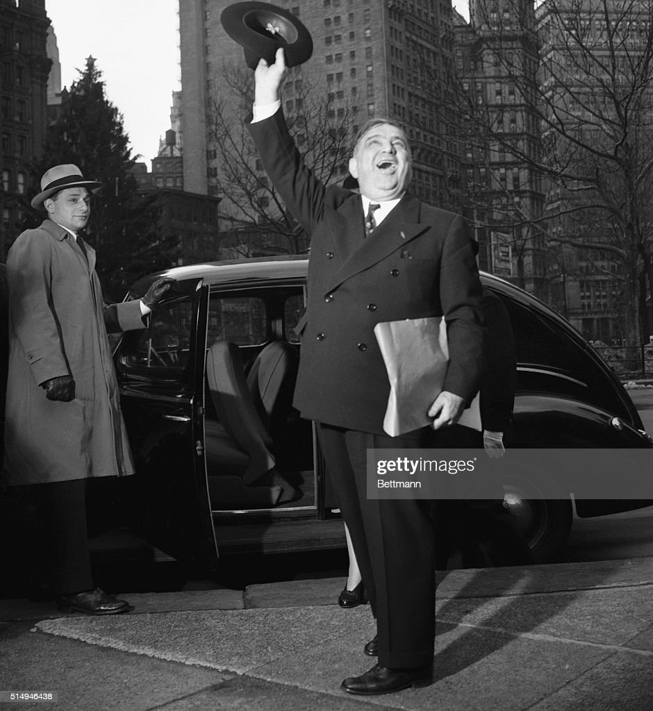 Former New York Mayor Fiorello H. LaGuardia, whose term of office ended at midnight on December 31, 1945, waves his farewell to friends on the steps of City Hall, where he reigned for twelve years.