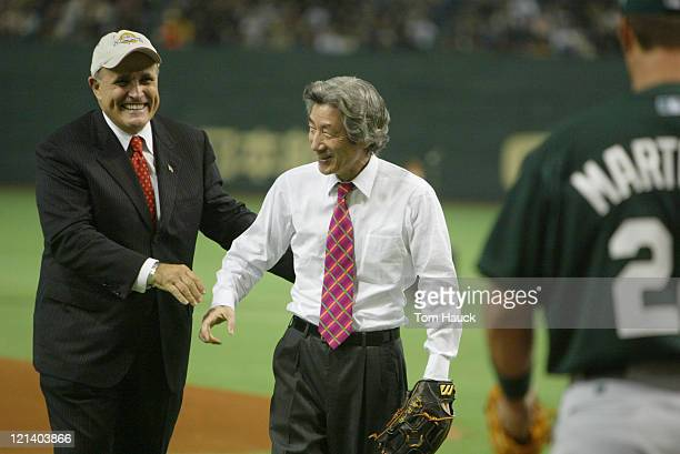 Former New York Mayor Rudolph Giuliani and Japan's Prime Minister Junichiro Koizumi throw out the ceremonial first pitches MLB Opening Day the New...