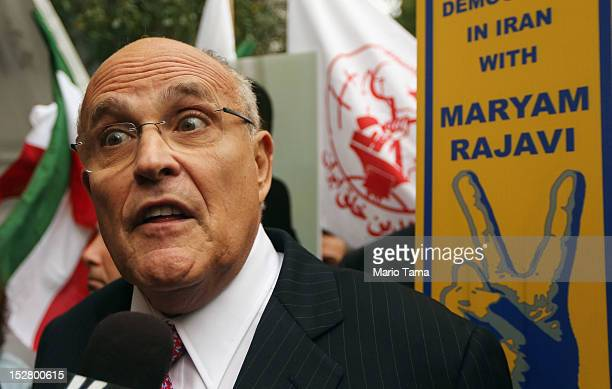 Former New York Mayor Rudolph Giuliani speaks to the media at a rally of groups opposing Iranian President Ahmadinejad's speech at the United Nations...