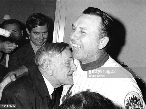 Former New York Mets manager Casey Stengel hugs current Mets manager Gil Hodges in the locker room after the Mets defeated the Baltimore Orioles in...