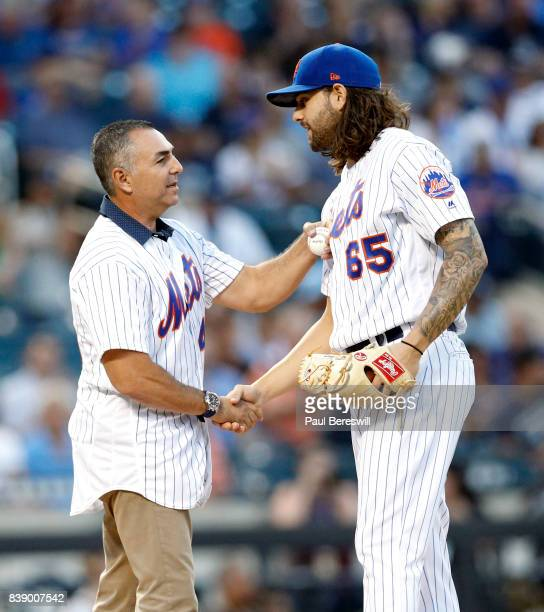 Former New York Mets pitcher John Franco shakes hands with starting pitcher Robert Gsellman of the New York Mets as Franco threw the ceremonial first...