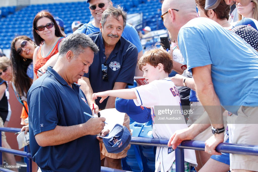 Former New York Mets starting pitcher Ron Darling signs autographs for fans prior to the game against the Atlanta Braves during a spring training game at Tradition Field on March 20, 2014 in Port St. Lucie, Florida. The Mets defeated the Braves 7-6.