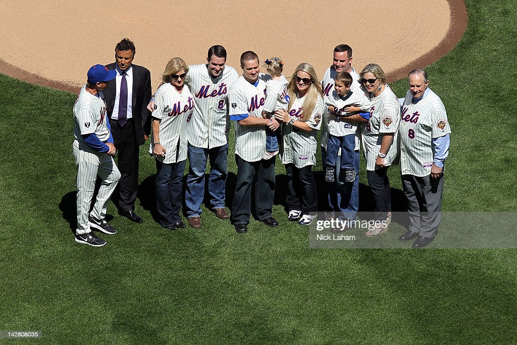 Former New York Mets Tim Teufel and Bob Ojeda pose on the field with the family of Former Mets' catcher and Hall of Famer Gary Carter including his wife Sandy (3rd L), son D.J. and daughters Kimmy and Christy as they honor Carter during their Opening Day Game against the Atlanta Braves at Citi Field on April 5, 2012 in New York City.