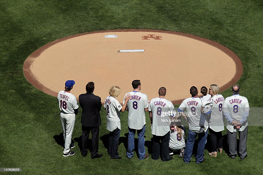 Former New York Mets Tim Teufel and Bob Ojeda stand on the field with the family of former Mets' catcher and Hall of Famer Gary Carter including his wife Sandy (3rd L), son D.J. and daughters Kimmy and Christy as they honor Carter during their Opening Day Game against the Atlanta Braves at Citi Field on April 5, 2012 in New York City.