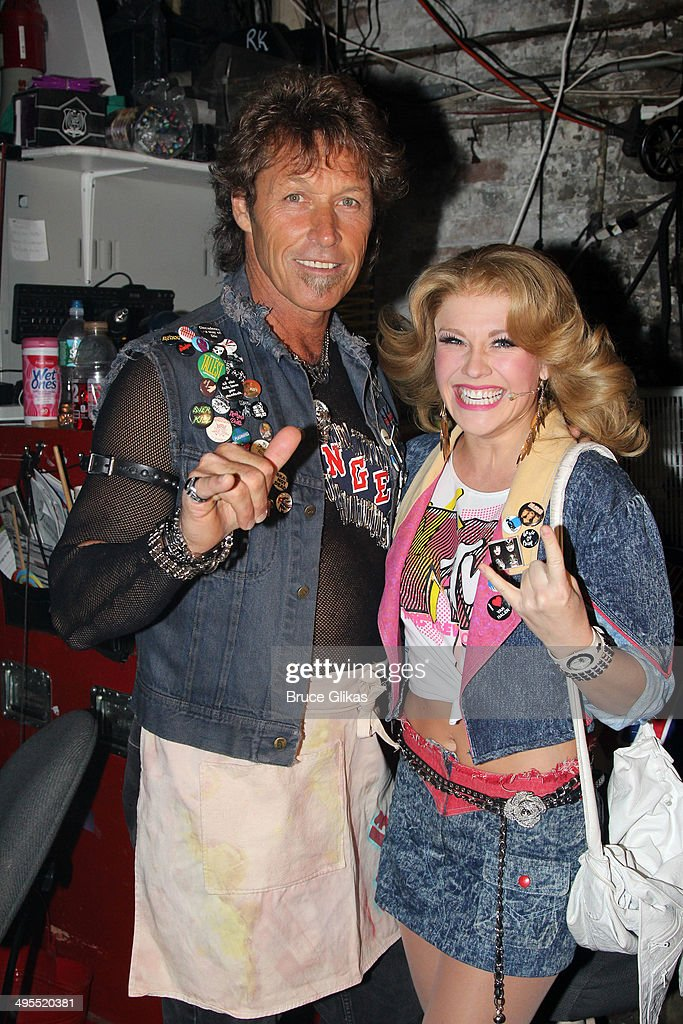 Former New York Rangers hockey player <a gi-track='captionPersonalityLinkClicked' href=/galleries/search?phrase=Ron+Duguay&family=editorial&specificpeople=598468 ng-click='$event.stopPropagation()'>Ron Duguay</a> makes his broadway debut and poses with Actress Carrie St. Louis as 'Sherry' backstage at the hit musical 'Rock of Ages' on Broadway at The Helen Hayes Theater on June 3, 2014 in New York City.