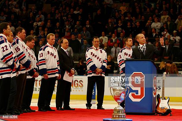Former New York Rangers player Adam Graves speaks during a ceremony retiring his jersey prior to a game between the New York Rangers and the Atlanta...