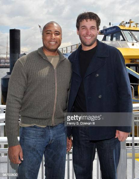 Former New York Yankee Bernie Williams and New York Met Jeff Francoeur attend the christening of Delta's Baseball Water Taxis at Pier 11 on April 27...
