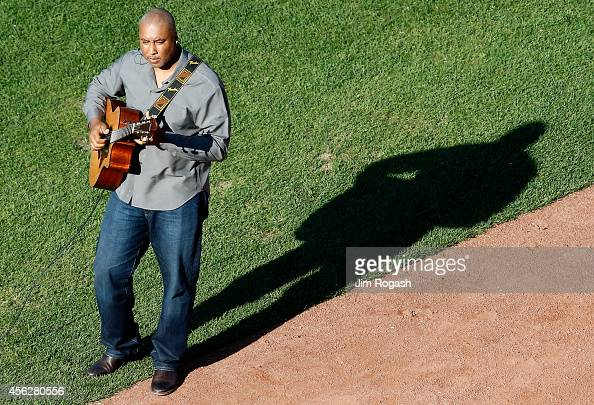 Former New York Yankee Bernie Williams performs during the last game of the season between the New York Yankees and the Boston Red Sox at Fenway Park...