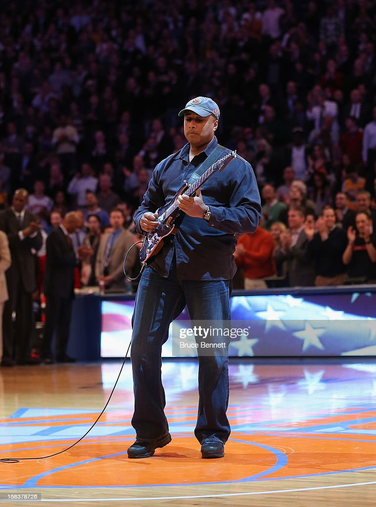 Former New York Yankee Bernie Williams performs the National Anthem prior to the game between the New York Knicks and the Los Angeles Lakers at Madison Square Garden on December 13, 2012 in New York City.