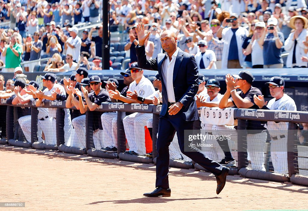 Former New York Yankee Derek Jeter is introduced during a ceremony for former teammate Jorge Posada prior to a game between the Yankees and the Cleveland Indians at Yankee Stadium on August 22, 2015 in the Bronx borough of New York City.