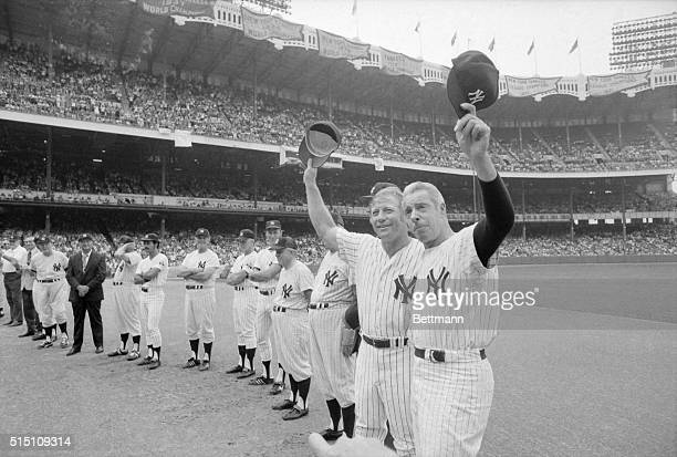 Former New York Yankee greats Mickey Mantle and Joe DiMaggio doff their caps to the crowd of 46293 on hand for the annual OldTimers' Game at Yankee...